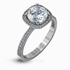 Featuring a contemporary take on a vintage style, this white gold engagement ring and band is complimented by .50 ctw of striking round cut white diamonds. Print Page