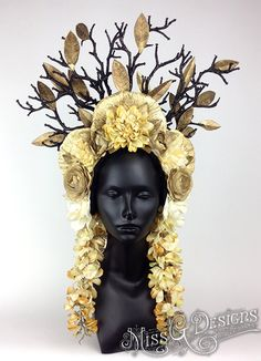 MADE TO ORDER    Hand-made headpiece with a variety of flowers in different shades of gold and cream. Accented with painted mushrooms and black