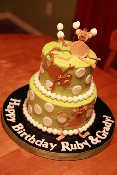 Monkey birthday cake for siblings. Chocolate cake with Reese's peanut butter cup filling and vanilla buttercream. Fondant monkeys and polka dots.
