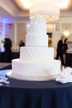 Elegant white cake: http://www.stylemepretty.com/2015/04/17/boston-marathon-survivor-nurse-tie-the-knot/   Photography: Prudente - http://www.prudentephoto.com/