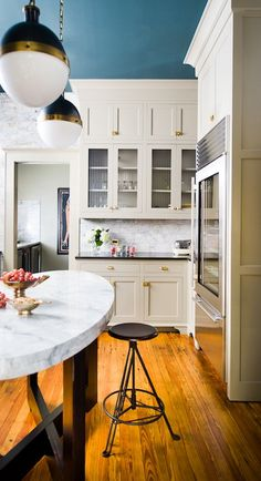 kitchens - Thomas O'Brien Hicks Pendant blue painted ceiling modern gray kitchen cabinets oval marble kitchen island honed black granite countertops marble subway tiles backsplash industrial stools Thomas O'Brien Hicks Pendant