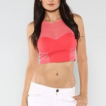 This one of our popular crop tops, its sleeveless solid knit  with mesh trim detail and zipper closure on back. Looks great with leggings