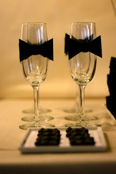 Little elements like adding tuxedo bow ties to champagne glasses can enhance the look of your table.