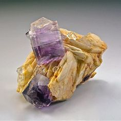 Fluorite, Baryte | #Geology #GeologyPage #Mineral Locality: Berbes, Berbes Mining area, Ribadesella, Asturias, Spain Dimensions: 35 mm x 40 mm x 60 mm Largest Crystal Size: 20 mm Photo Copyright © Rudo Geology Page www.geologypage.com