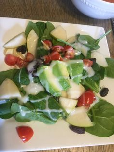 Spinach, pears, raisins, sliced almonds, tomatoes, avocado, home made Creamy Vidalia Onion Dressing - learn how in class - this photo has chicken breast in it but you can leave this out and make vegetarian.