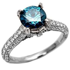Blue diamond engagement rings are beautiful and unique. You can't help but notice a blue diamond engagement ring on a woman's finger. Round Diamond Engagement Rings, Diamond Wedding Rings, Diamond Rings, Ring Engagement, Wedding Bands, Blue Rings, Beautiful Rings, Diamond Jewelry, Gold Jewelry