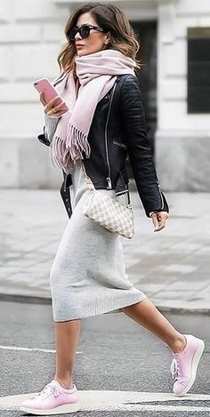 #spring #outfits woman wearing black leather jacket and gray midi dress holding rose gold iPhone 7 Plus while crossing gray asphalt road. Pic by @perfect_fashion_styling