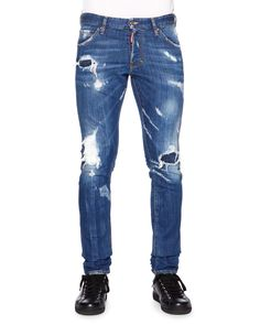 """DSquared2 """"Cool Guy"""" denim jeans with destroyed and patchwork details. Five-pocket style. Leather logo patch at back waist. Fading and whiskering through legs. Slim fit; slightly tapered at ankles. Bu"""