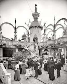 This Helter Skelter at Coney Island in Brooklyn, New York, was clearly popular in 1905 with dozens of people watching as participants came tumbling down the ride