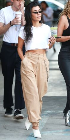 Kourtney Kardashian is the queen of cool-girl style. And her latest look proves that less is always more with a cropped white T-shirt, I am Gia pants ($84; iamgia.com), white mules, and narrow sunglasses.