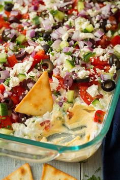 Forget the classic seven layer bean dip, who needs that when you've got this incredibly fresh and utterly delicious Seven Layer Greek Dip! This dip begins