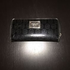 Black MK Wallet Michael Kors black wallet. Used a couple times. Spilled something in my purse so now the zipper is a little tough to close but it looks like brand new! Comes with bag! ❌no trades❌ Michael Kors Bags Wallets