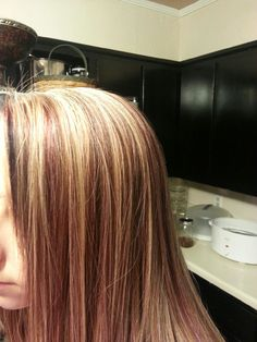 Light brown hair with blonde highlights and red!
