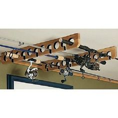 Shop Cabela's large collection of fishing rod and reel storage products. Featuring racks, cases, tubes and holders for your fishing rods or reels. Fishing Rod Stand, Fishing Pole Storage, Fishing Lures, Fishing Rods, Fishing Stuff, Pole Holders, Rod Rack, Spinning Rods, Rod And Reel