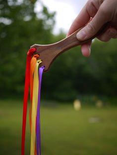 Twirling ribbons on old paintbrush handle
