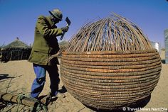 "Africa | An Owambo man (Namibia) making a ""oshigandhi"" granary basket. 