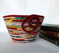Round Coiled Fabric Bowl - Country Cottage Chic. via Etsy. I like the coil design they used at the end. I haven't experimented with them just yet.