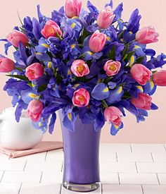Purple Irises and Pink Tulips. I love the pop of pink and the rich hue of the purple.