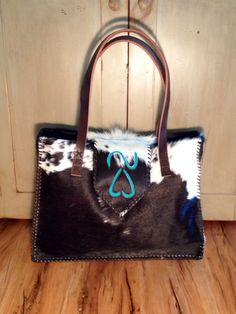 The Buckaroo tote with custom ranch brand in turquoise suede. From gowestdesigns.us