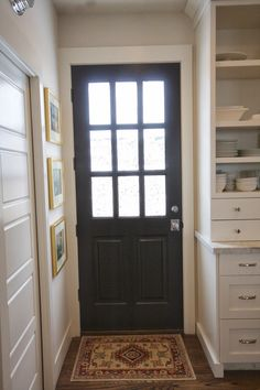 Door, Benjamin Moore: Onyx, cabinets & trim: Swiss Coffee. Walls, Winds Breath.