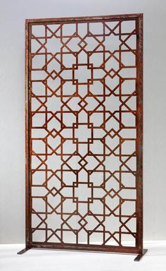 Architectural screens can be used to define or divide existing areas, allowing new spaces to be created from old and adding the rare beauty of oxidised metal to the natural elements of the space. Our range of rusty finish Screens feature a selection of complex geometric patterns that are uniquely Moroccan. Each comes with it's own stand, but can be purchased without, allowing you to feature the screen on a wall where it may be back-lit, or incorporated into gates or fencing as an…