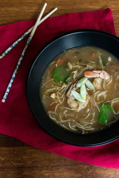 Spicy Asian shrimp soup with onion, chili paste, lime, and noodles for an complete meal.