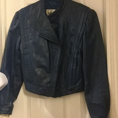 Wilson leather blue jacket Genuine leather,blue color,zipper close,secret pockets on each side,with Florida weather,No need of leather jacket. Wilsons Leather Jackets & Coats