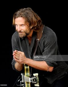 Actor Bradley Cooper is filmed performing and introducing Kris Kristofferson on the Pyramid stage on day 2 of the Glastonbury Festival 2017 at Worthy Farm, Pilton on June 2017 in Glastonbury, England. Beautiful Blue Eyes, Gorgeous Men, Hollywood Actor, Hollywood Actresses, A Star Is Born, We Are The World, Lady Gaga, Movie Stars, Ali Larter