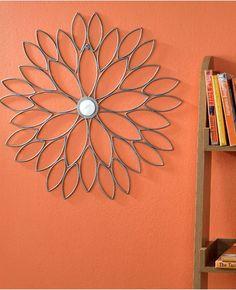 Orange walls and striking metal wall art