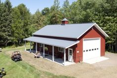 This garage was built for Ed of Cloquet, MN Special Features: Morton& Hi-Rib Steel in Red and Charcoal Porch Cupola Wainscot . Metal Shop Houses, Metal Shop Building, Building A Pole Barn, Building A House, Barn Houses, Metal Garage Buildings, Metal Garages, Shop Buildings, Pole Barn Garage