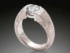 Mokume Gane Diamond Ring in mokume of non-etched 14K palladium white gold and sterling silver in woodgrain pattern with platinum half bezel.