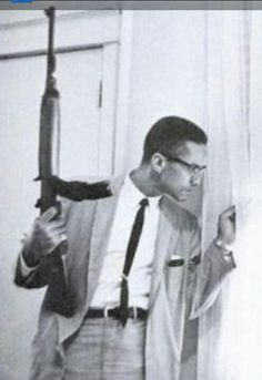 Malcolm X famous picture holding a M1 carbine rifle