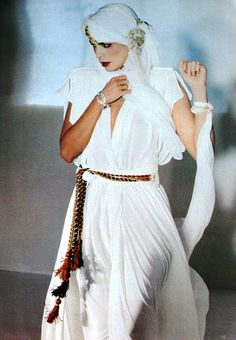 Bianca Jagger wears exotic silk chiffon, Vogue UK December 1980