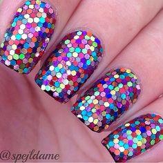 A pretty multi colored glitter nail art design in a mosaic like theme.