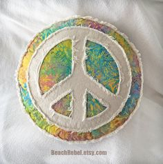 Peace sign boho pillow, tropical leaf batik in rainbow tie dye turquoise yellow orange purple and distressed natural denim round pillow