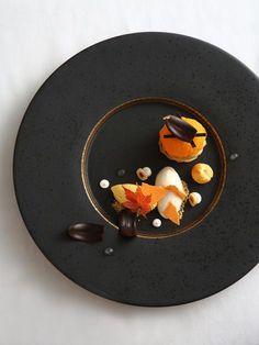 Autumn Dreams | Choux pastry, hazelnut pastry cream, pumpkin ice cream, honey ice cream, yogurt meringue by chef Vicky Lau. - See more at: http://theartofplating.com/editorial/qa-vicky-lau-on-the-harmony-of-food-art/#sthash.wtVto9i5.dpuf
