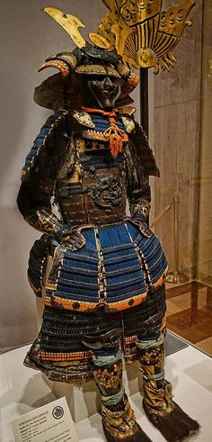Yokohagidō Armor with shakudō cuirass crafted from an alloy of copper and gold depicting a coiled dragon Helmet 14th century CE Armor 18th century CE Japan