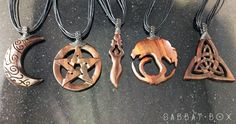 A beautiful crescent moon necklace that has been carved from wood and comes with…