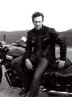 Hugh Laurie, rides a Triumph Bonneville.