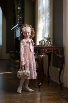 Modest blush pink little girls' party dress: the Little English Rosemary Dress. Sweet tulle and Venetian lace. Shop modest bridesmaids dresses, ruffles, and lace. www.daintyjewells.com