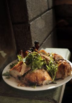 The roasted chicken appears like an offering to the culinary gods during dinner at Zuni Cafe in San Francisco.