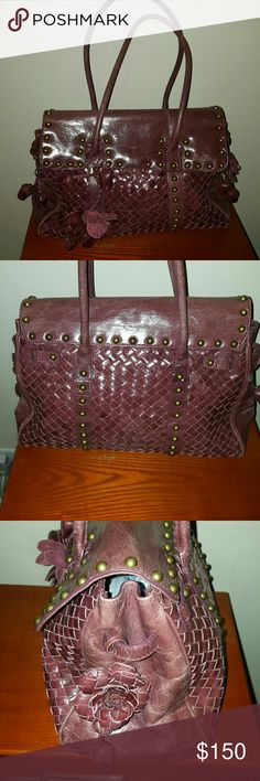 Vintage Beverly Feldman Woven Women Bag Beautiful leather woven Beverly Feldman handbag with detailed flowers in great condition.  Detail on this bag is amazing.  Excellent condition  Priced Accordingly additional photos per request this bag is actually a deep dark burgundy instead of in the photos it looks more like brown  Vintage Beverly Feldman Woven Women Bag 100% Authentic Unique Style XL - Brown/Tan Leather with burgundy in it as well  Best Offers are always Welcomed! Few Scuffs and…