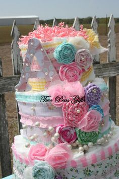 Shabby Chic Diaper Cake by twopeasgifts on Etsy, $85.00.  love the flowers (could attach a bunch of baby headbands)