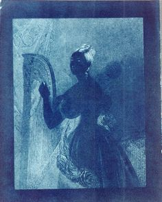 Portrait - Cyanotype - Woman with a harp. An experimental cyanotype of an engraving of a lady with a harp, by Sir John Herschel (1792-1871), 1842.