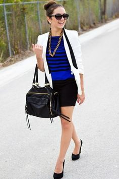 White blazer with black collar + blue layered tops + black skirt/shoes + gold necklace