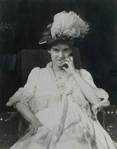 Elsie Bell Grosvenor stares straight at the camera in this portrait taken in 1901, possibly when she was pregnant with Melville B. Grosvenor. She is wearing a hat decorated with a huge ostrich feather.Photograph by Gilbert H. Grosvenor, National Geographic Creative