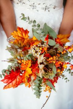 We couldn't imagine a more perfect fall-themed bridal bouquet.   Wedding Planners: Vanessa Velasco and Pat Wong
