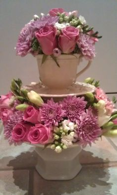 floral arrangement in stacked tea cups Now I can give something that i made. I Will do this!