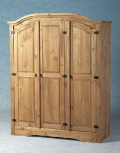 Corona 3 Door Pine Wardrobe.  Comes flatpack so we could assemble it in the room.  Too bad it's not made in america!