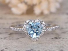 Perfect 1.25 Carat Heart shape Aquamarine and Diamond Halo Engagement Ring in White Gold. This is a beautiful vintage design sparkling aquamarine wedding engagement ring highlights total 1.25 carats perfect real blue aquamarine and glittering diamonds and is made in solid 10k White Gold. Handmade by our skilled artisan Blue Wedding Rings, Diamond Wedding Rings, Aquamarine Wedding, Diamond Rings, Wedding Bands, Heart Wedding Rings, Heart Rings, Solitaire Rings, Solitaire Diamond